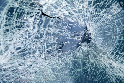 Image of a broken windshield as the results of a car crash in Portland, OR.