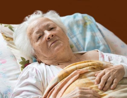 elder lady lying in bed