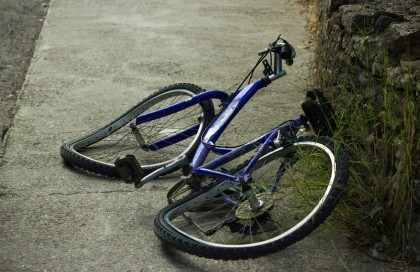 A bicycle accident lawsuit is seeking about $155,000 for a plaintiff who broke his collarbone when a cop stuck his arm out in from of the rider.