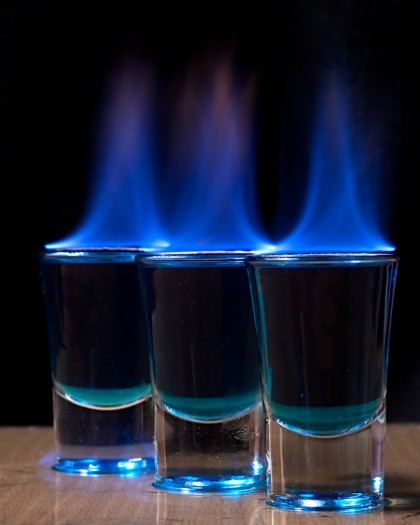 A burn injury lawsuit is seeking $49,000 from a Portland strip club that allegedly served the plaintiff a flaming shot of booze that ended up burning him.