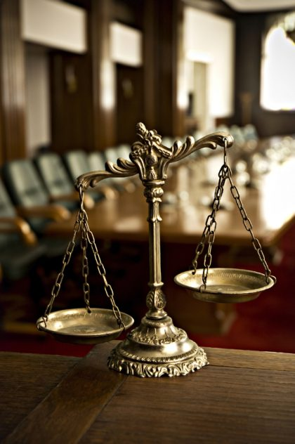 scales of justice in courtroom
