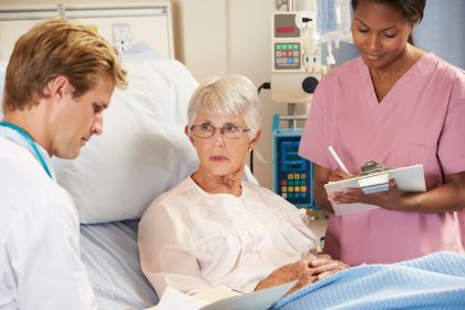 doctor and nurse consulting with elder patient
