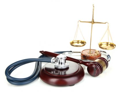 stethoscope with gavel and scales